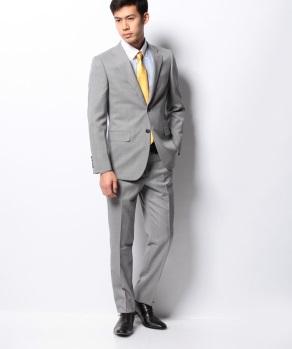 ゴールドのネクタイ着用のスーツ画像